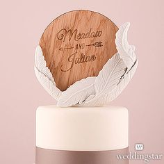 White Feather Porcelain Wedding Cake Topper with Personalized Veneer Disc in Free Spirit Design http://www.weddingstar.co.za/product/white-feather-porcelain-wedding-cake-topper-with-personalized-veneer-disc-in-free-spirit-design