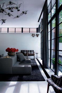 black iron pane windows, with curtains Drama