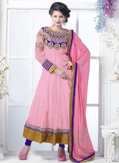 Stunning pink georgette anarkali suit . This pretty attire is showing some incredible embroidery done with zari, resham embroidery work, lace work and stone work. comes with a fancy matching blue bottom and pink dupatta.