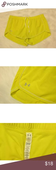 Under armour neon yellow shorts S/P Under armour neon yellow shorts. With white draw string. Preowned good condition. Please see pictures for details. Feel free to message me if you have any questions. Please see measurements below thanks. Measurements size: SM/P waist measured across laying flat:15in length waist to bottom 9.7in Under Armour Shorts