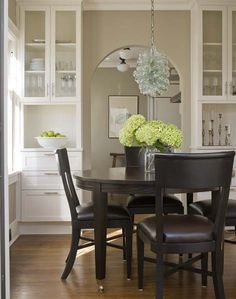 This kitchen is beautiful. I love the light colors, mixed with the dark table and chairs. So clean! (Which is never the case with my kitchen.)