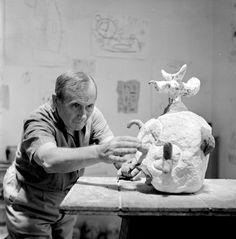 Juan Miro working on a plaster sculpture in his studio in Montroig