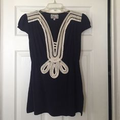 Anthropologie crochet V-neck blouse Baraschi for Anthropologie ruffled cap sleeve, deep V-neck blouse with cinched waist and crochet embellishment. Heathered navy background with cream crochet details (100% cotton). Cut long. Worn once. Perfect condition. Anthropologie Tops Blouses
