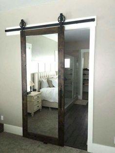 A barn door sliding mirror . . . such a great idea!