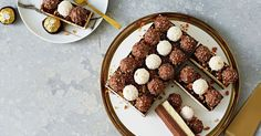 A topping of Ferrero Rocher and Raffaello takes this triple chocolate slice to new dessert heights!