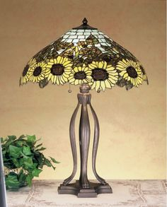 Buy the Meyda Tiffany 47592 Tiffany Glass Direct. Shop for the Meyda Tiffany 47592 Tiffany Glass Vintage Stained Glass / Tiffany Table Lamp from the Wild Sunflowers Collection and save. Lamp Light, Lamp, Chandelier Lamp, Glass, Vintage Lamps, Lights, Tiffany Lamp Shade, Tiffany Style Lamp, Stained Glass Table Lamps