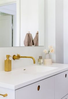 We love the golden details in this bathroom - it does not always have to be traditional.