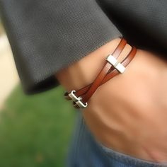 "This bracelet can be worn by both men and women. Simple design of tan genuine leather criss-crossed and embellished with decorative silver sliders. The strong magnetic clasp allows for easy attachment yet strong enough to not detach under normal wear. Great for Valentine'sDay! Please specify if you want a man's size or woman's size when you order.Genuine tan leatherSilver-Plated SiFastens with sturdy magnetic claspMen's size= 8 1/2"" longWomen's size 7 1&#x2F..."