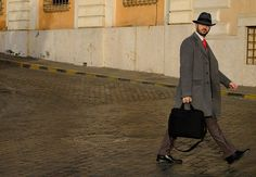 """""""Walk the Walk""""... Rome Italy After shooting sunrise at the Roman Forum all we had to do was turn around and watch all the beautifully dressed Italian people walking to work. Suddenly we were street photographers! This gentleman made it easy. I imagined him to be a spy. Or a plastic surgeon. It could go either way.   Specs:  Fujifilm X-Pro 2 16-55mm lens ISO 400 f/5.6  #fujifilmx_us Fujifilm X Series US"""