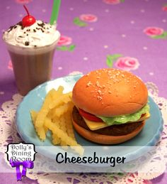 Enjoy this classic flame-grilled hamburger on a homemade bun with lettuce, tomatoes, and cheddar cheese. It'll make any day feel like a hot summer barbecue in your own backyard. Served with a pile of crispy fries and a frosty chocolate shake.