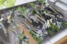 Boutonnieres with lavender, snowberries, rosemary, brunia, and dusty miller by Anastasia Ehlers Floral Design #wedding #flowers