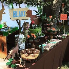 Amazing dessert table at a dinosaur birthday party! See more party ideas at CatchMyParty.com!