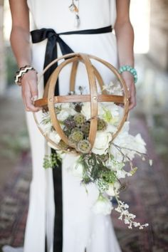 rustic vintage wood globe with succulent wedding bouquet in a wooden globe