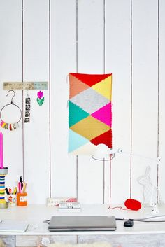 Wood and Wool Stool Diamond and Triangle Harlequin Inspired Crochet Cushions design as wall art