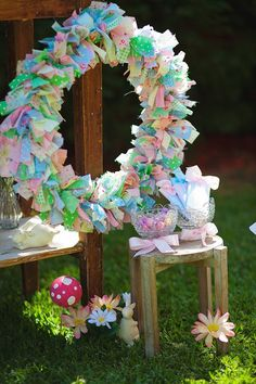 LOVE this spring wreath made out of fabric strips! Via Kara's Party Ideas | KarasPartyIdeas.com