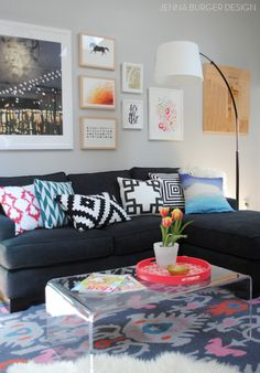 Sofa with eclectic patterned throw pillows via Jenna Burger