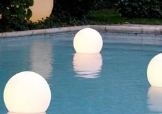 globe-shaped floating lighting fixtures