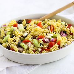 Easy Greek Pasta Salad, with lots of veggies and a flavorful dressing, is a quick & easy, full of flavor side dish, perfect for summer picnics & barbecues.