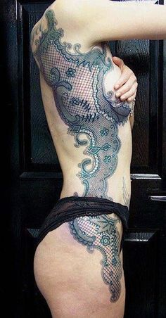 lacy tattoo, huge but so artistic and well done