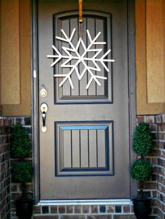 hang a giant snowflake in lieu of a traditional wreath! Let it Snow!
