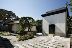 ryo matsui conceals guesthouse windows with perforated brick walls