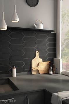 The backsplash and counters are similar tones, but are broken up by the unique tile shape used for the backsplash. Gorgeous!