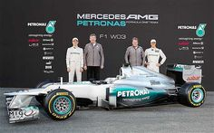 Nico Rosberg and Michael Schumacher seem happy with the new Mercedes-Benz F1 W03 model for 2012.
