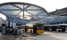 in aarau, switzerland, architects vehovar & jauslin with engineering firm formTL, have constructed a large floating structure that stands over the town's bus station. supported by a steel table, the transparent canopy is made from an upper blue and lower clear ETFE-foil, printed with a bubble pattern that together creates a sinuously formed air-tight cushion that is butt-welded without visible repetition.