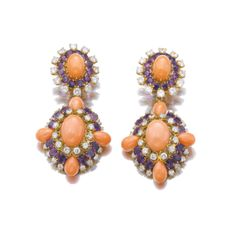 PAIR OF CORAL, AMETHYST AND DIAMOND PENDENT EAR CLIPS, VAN CLEEF & ARPELS, 1970S  Estimate:     19,000 - 28,000 CHF (20,083-29,596 USD)  LOT SOLD. 104,500 CHF (110,456 USD) (Hammer Price with Buyer's Premium)  Each of cluster design, set with cabochon corals, oval and circular-cut amethysts, and brilliant-cut diamonds, pendants detachable, signed VCA and numbered, French assay and maker's marks.