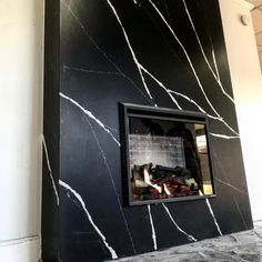 High-impact comes to life in this fireplace wrapped in Silestone Marquina by Alliance Granite. Mosaic Tile Fireplace, Marble Fireplace Surround, Stone Mantel, Marble Fireplaces, Fireplace Surrounds, Fireplace Design, Contemporary Fireplace Mantels, Fireplace Feature Wall, High Ceiling Living Room