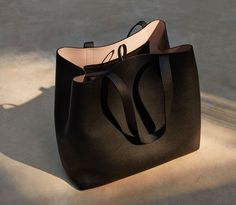 The New Structured Leather Tote: selective details like interior lateral ties allow for an unexpected evolution when looped in a bow. University Bag, Vegan Handbags, Stylish Handbags, Leather Handbags, Leather Bags, Leather Briefcase, Pink Leather, Work Bags, Luxury Bags