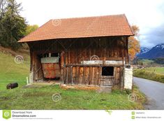 Photo about A rustic old wooden barn in rural Switzerland with clay tile roof half door and garage for harvesting wagon. Image of miniature, roof, wagon - 106203074 Half Doors, Wooden Barn, Clay Tiles, Switzerland, Garage Doors, Shed, Miniatures, Outdoor Structures, Rustic