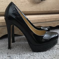 """Chinese Laundry """"Wonder"""" platform pump The classic, versatile black platform pump. Only worn once indoors. You can never go wrong with some black patent leather heels. Platform is about 1inch and heel is about 4.5inches Chinese Laundry Shoes Platforms"""