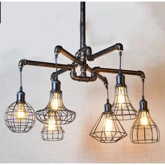 The Luminaire pipe chandelier is not simply about illumination - it's about creating a focal point out an industrial style and design. Shop the entire Luminaire collection here. Diameter x H Includes 6 Edison bulbs Industrial Chandelier, Industrial Pipe, Pendant Chandelier, Industrial Lighting, Chandelier Lighting, Industrial Design, Chandeliers, Industrial Light Fixtures, Ceiling Lighting