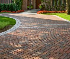 Permeable Driveway - Built using recycled clay bricks placed on gravel. Very good solution for wet climates.  >> Click for more Driveway Ideas!