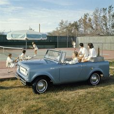 Couples Watch Tennis Match from International Scout Pickup by Wisconsin Historical Images, via Flickr