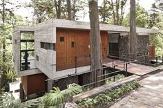 Built by PAZ Arquitectura in Guatemala City, Guatemala with date 2011. Images by Andres Asturias. Located on a dense hillside forest in the Santa Rosalía area of Guatemala City, Corallo House integrates the existing...