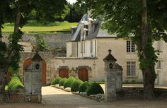 driveway entrance of enchanting french home ...