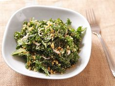 The key to a great kale Caesar salad is to marinate the kale in straight olive oil while you prepare the dressing and the croutons. The olive oil helps break down the leaves, turning them from tough to tender-crisp.