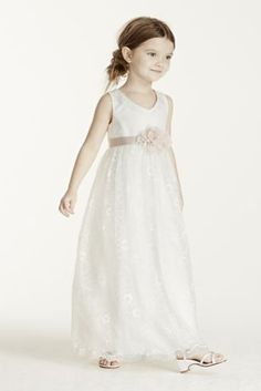 A dress that your flower girl willlove to wear again, this beautiful lace tea length dress is a keeper!  Tank bodice is designed with a back zip and no sleeves.  Dress is made from soft flowing lace fabric, giving this dress a whimsical feel. Shown with sash Style S1052 (not included.) Fully lined. Imported. Polyester. Dry clean.