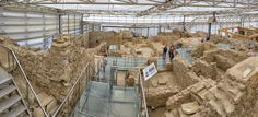 panorama of terrace houses - panorama of terrace houses in ephesus .the excavation and restoration work is done under a closed area to protect against environmental factors.the panorama gives a better idea of the size of work done,truly amazing work and findings,fascinatins.ephesus is now a unesco World heritage site..