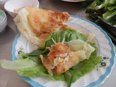 Banh Xeo... A Street dish found all over Vietnam but Saigon seems to be the best... and this restaurant istge best of the best.. near the pink church we can arrange lunch there.