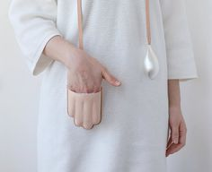 `Somewhere for your hand`by Ruoyan Wang. Silver-plated Copper, Veg-tanned Leather, Merino Wool.