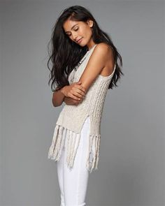 Try wearing this fringe sweater top with dark jeans for a fall look.