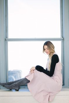 baby pink and black layers paired with Stuart Weitzman lowland boots