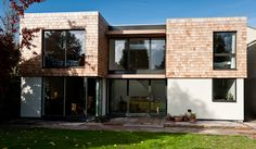 Modern shingles/stucco/black window casing - theme for house w/ maibec bleaching oil to rapidly age shingles