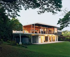 Ipe decking extends from the actual deck to the home's interior.  Photo by: Linny Morris