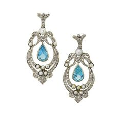 A pair of aquamarine, diamond and pearl earrings   Each pear-shaped aquamarine drop within a brilliant-cut diamond and pearl oval-shaped foliate cartouche to a brilliant-cut diamond V-shaped surmount, post fittings, 5.2cm long