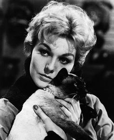 Kim Novak in her role as the NYC witch in Bell Bok and Candle, with her familiar Pyewacket