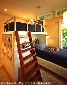 d.i.y. bunk bed with industrial pipe railing (note how the beds are, not only perpendicular, but are not attached to each other).